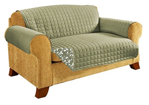 A two seater sofa with a plush quilted sofa protector in khaki and nice pattern design