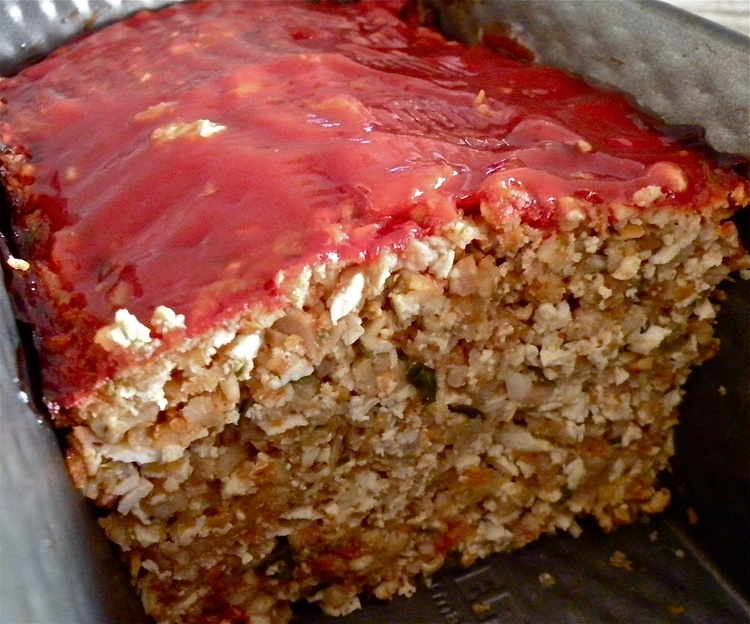 Vegetarian Meatloaf topped with Ketchup