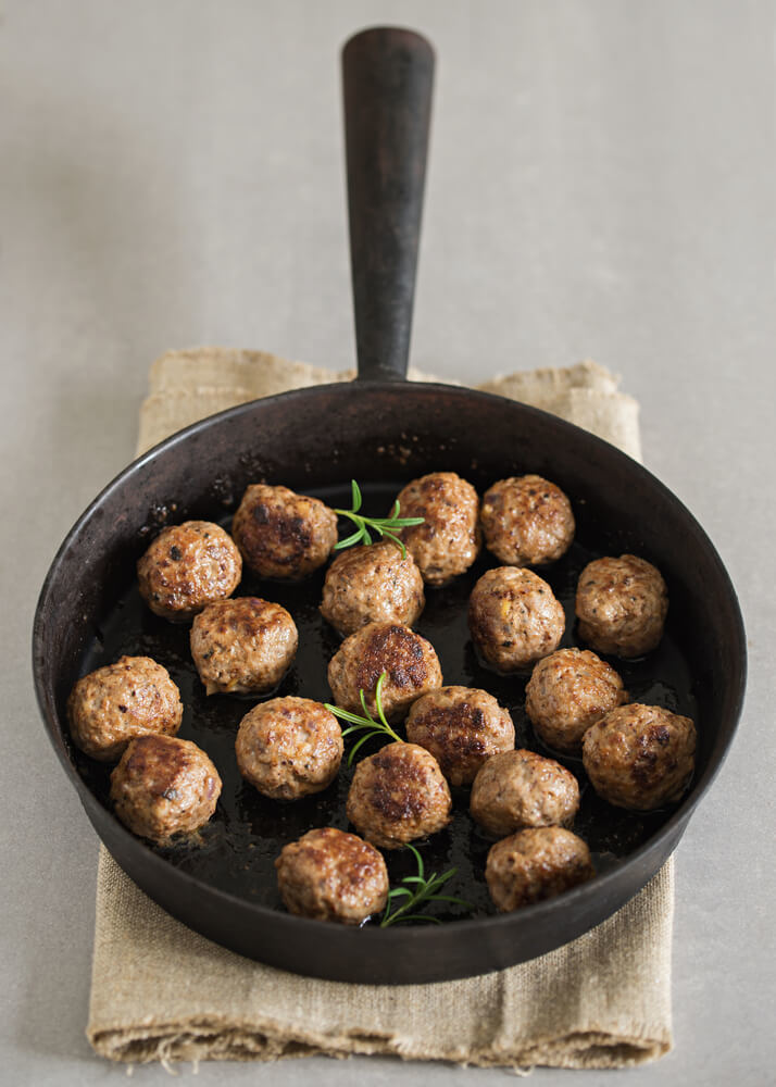 Beef meatballs cooked in a skillet and herbs rosemary